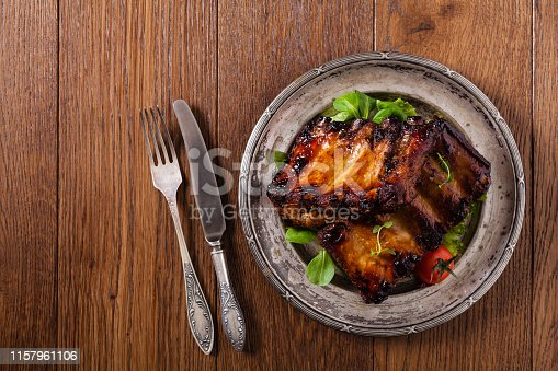 istock Roasted ribs, served on an old plate. 1157961106