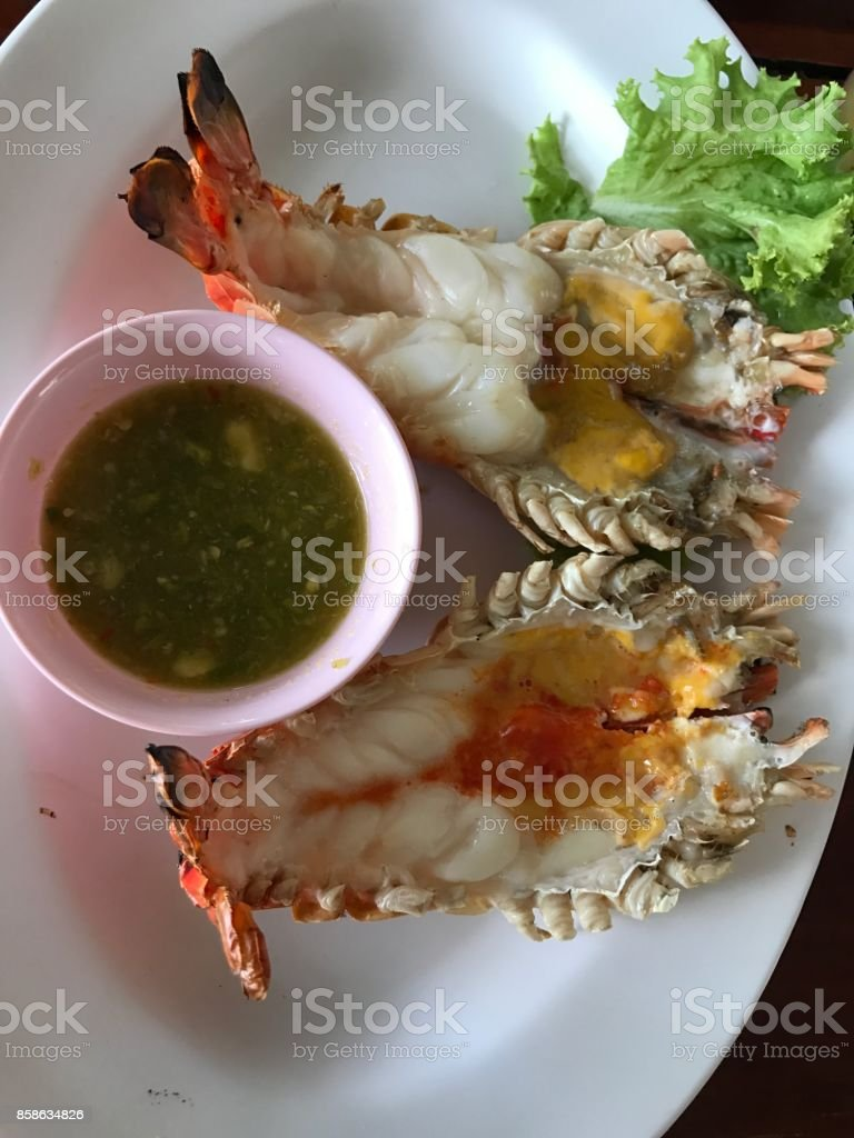 Roasted river prawn served with Thai spicy seafood sauce. stock photo