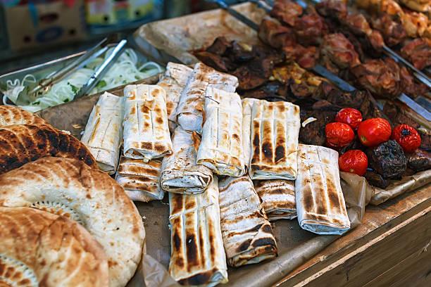 roasted rolls of bread lavash filled with herbs feta cheese. - kräuterfaltenbrot stock-fotos und bilder