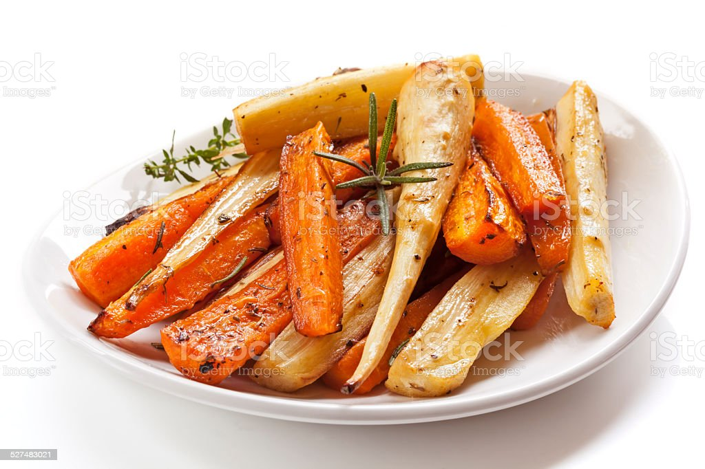 Roasted Root Vegetables in White Dish Isolated stock photo