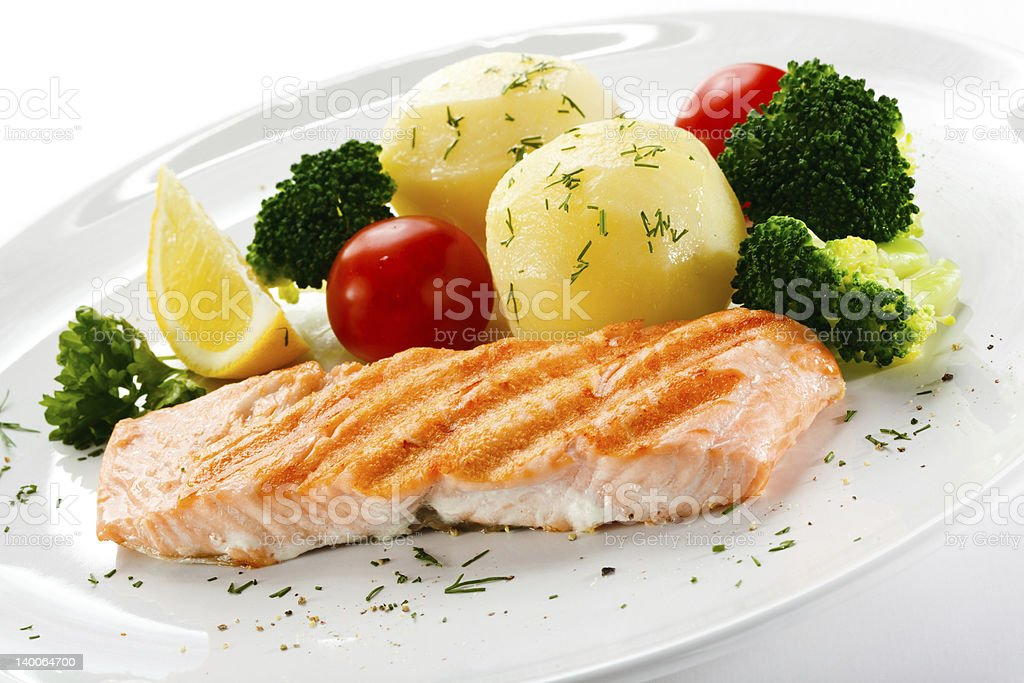 Roasted salmon and vegetables royalty-free stock photo