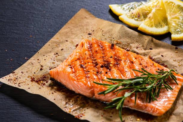 Roasted salmon steak on stone plate stock photo