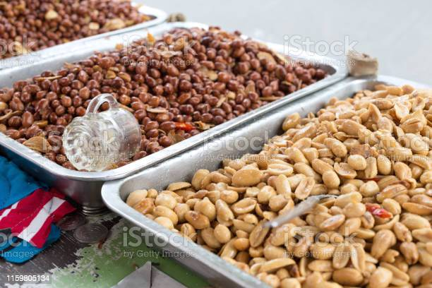 Roasted salted peeled and unpeeled crude peanuts on metal trays on picture id1159805134?b=1&k=6&m=1159805134&s=612x612&h=nmv7od42qkuq2lxxep9h p5cq7sb2zscvv9zyxo54zu=