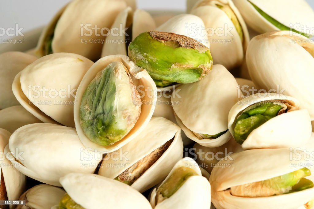 Roasted salted Pistachios are dried nuts close up stock photo