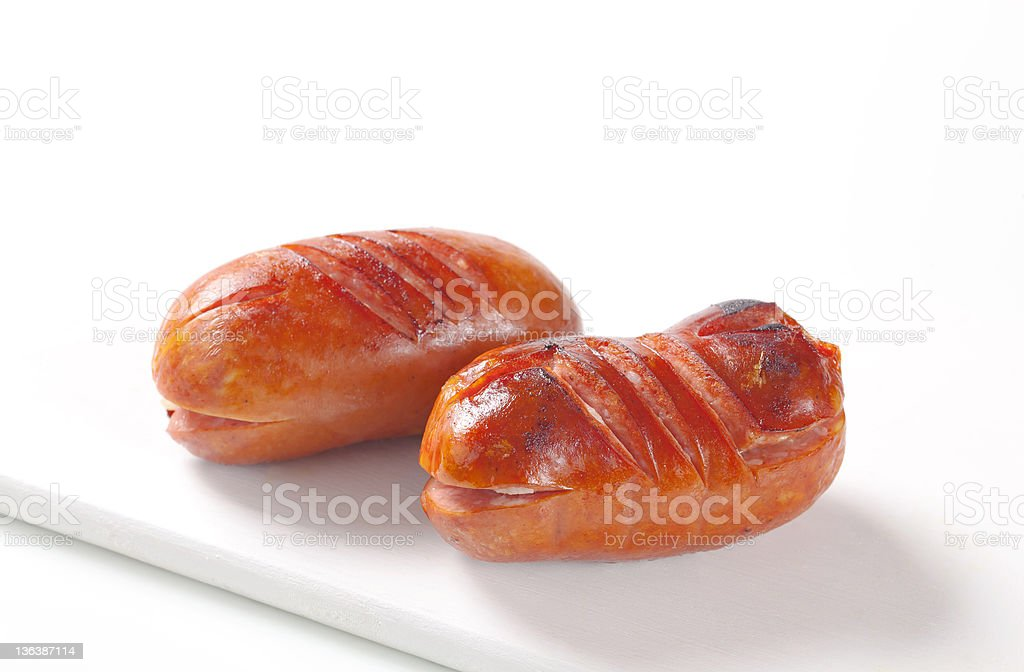 Roasted sausages on a cutting board royalty-free stock photo