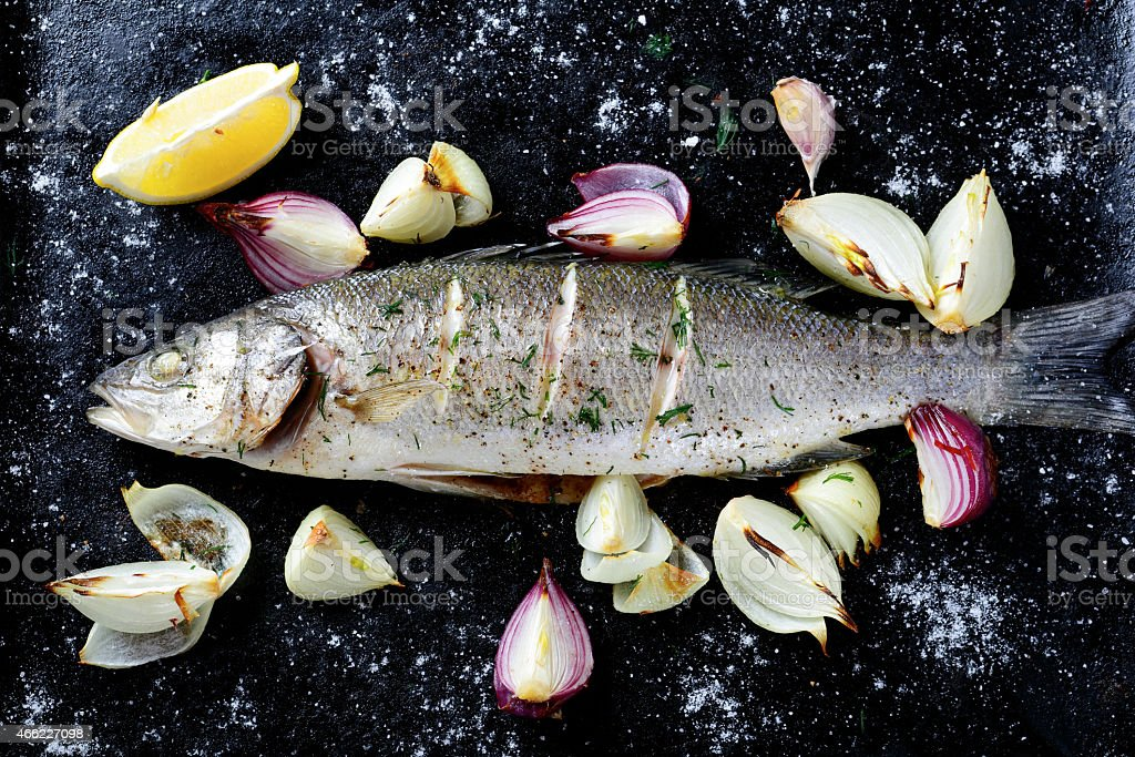 Roasted Sea Bass on a dark background stock photo
