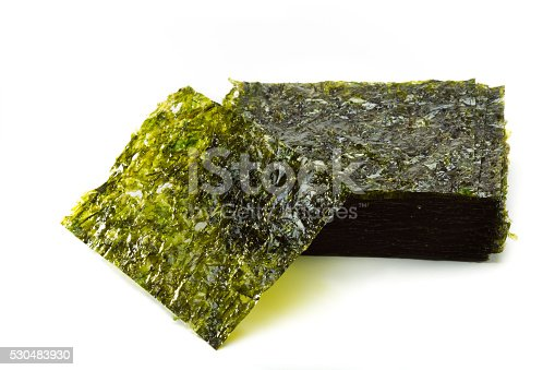 Gim or Kim is Korean roasted seaweed cut into squares on white isolated against a white background