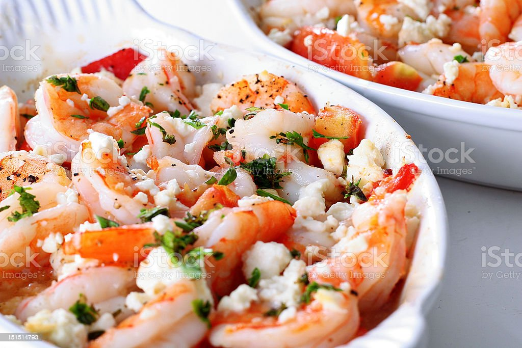 roasted shrimp with tomatoes and feta cheese stock photo
