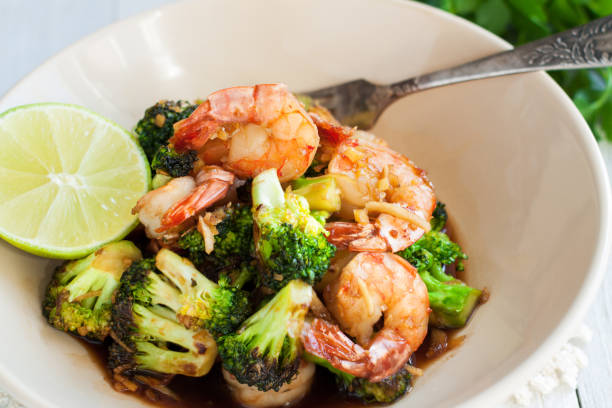 Roasted shrimps with broccoli and honey and garlic sauce stock photo