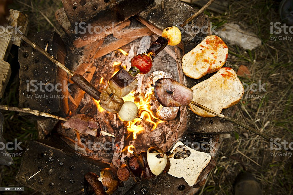 Roasted skewer with meals and vegetables. royalty-free stock photo