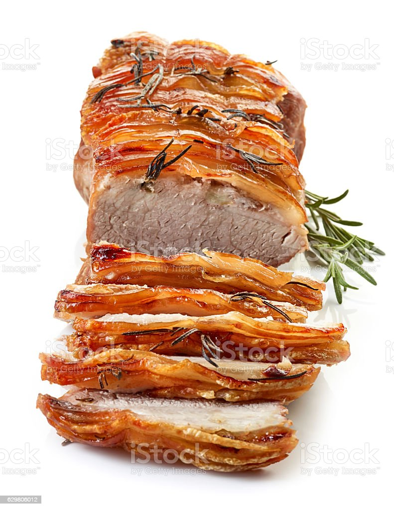 roasted sliced pork and rosemary stock photo
