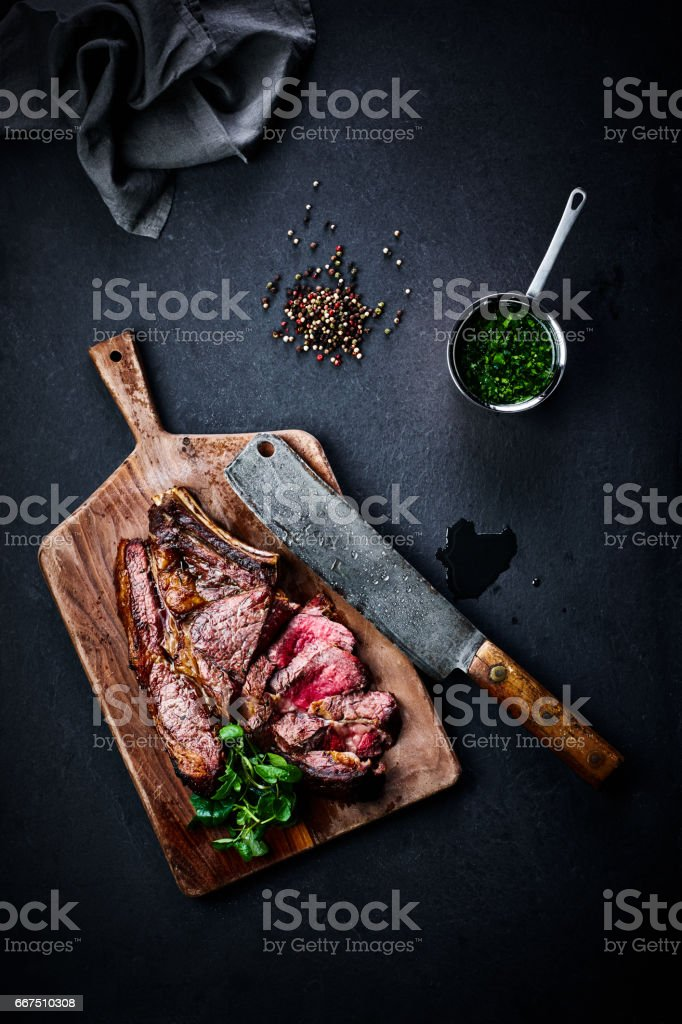 Roasted steak with peppercorns and peas stock photo