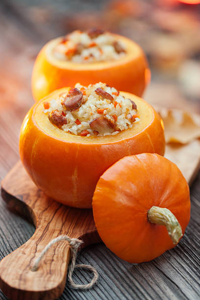 Roasted stuffed pumpkins stock photo