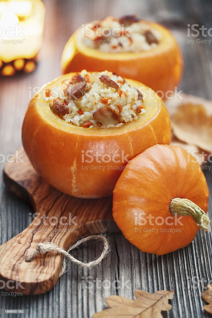 Roasted stuffed pumpkins Roasted little pumpkins stuffed with chicken meat, vegetables and rice Autumn Stock Photo