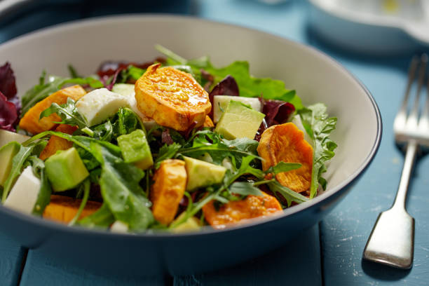 Roasted sweet potato and avocado salad stock photo