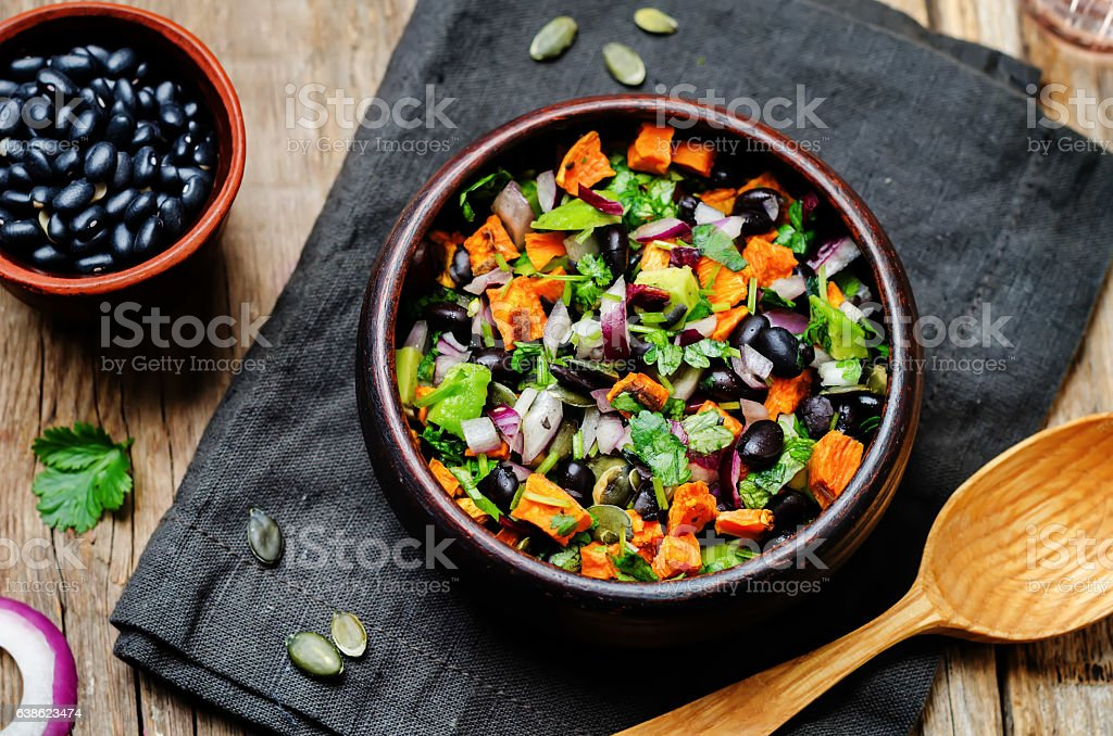 Roasted sweet potato black bean pepita avocado salad stock photo