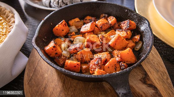 Sweet potatoes roasted in a cast iron skillet