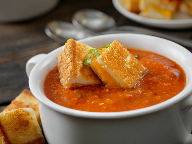 Roasted Tomato, Garlic and Basil Soup with Grilled Cheese Croutons stock photo
