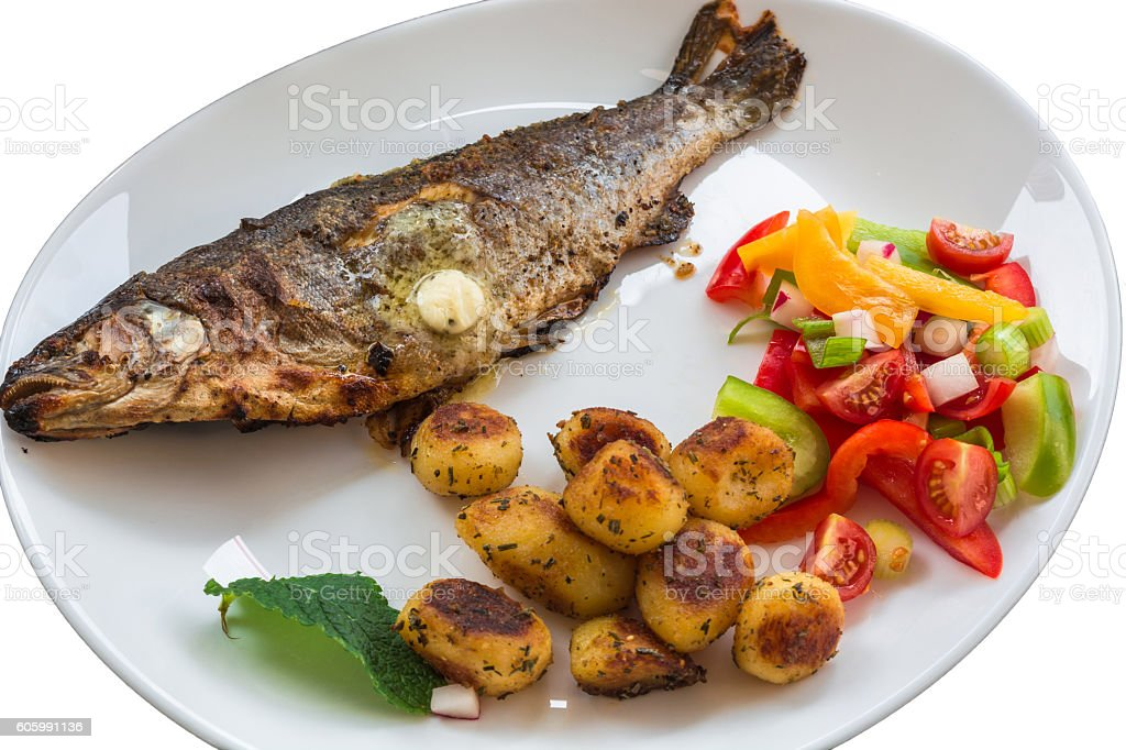 Roasted trout on white plate stock photo