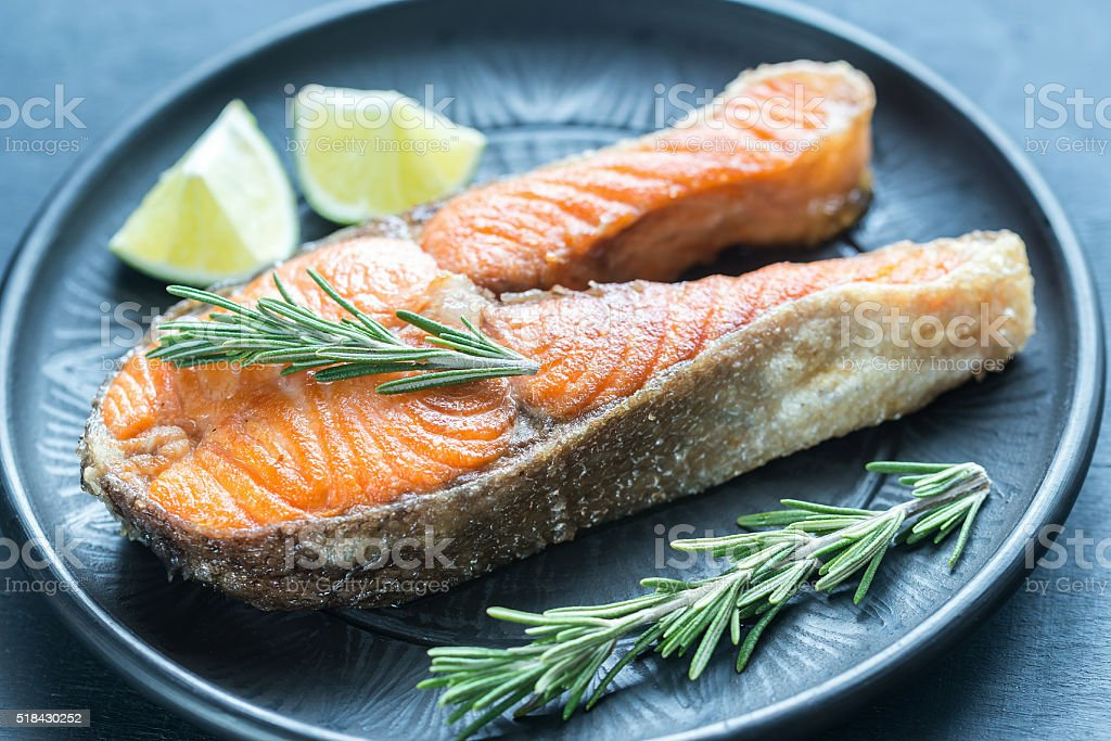 Roasted trout steak with fresh rosemary stock photo