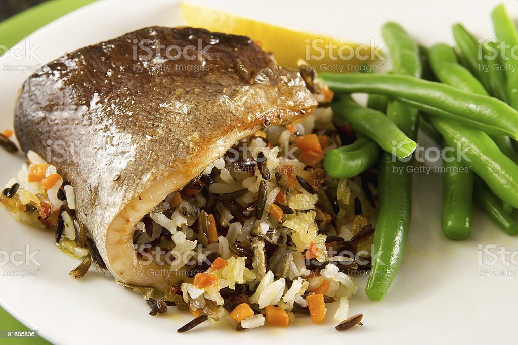 Roasted trout with rice royalty-free stock photo