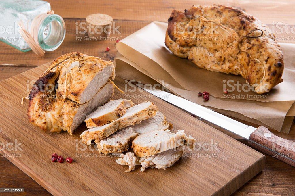 Roasted turkey breast on wooden plank stock photo