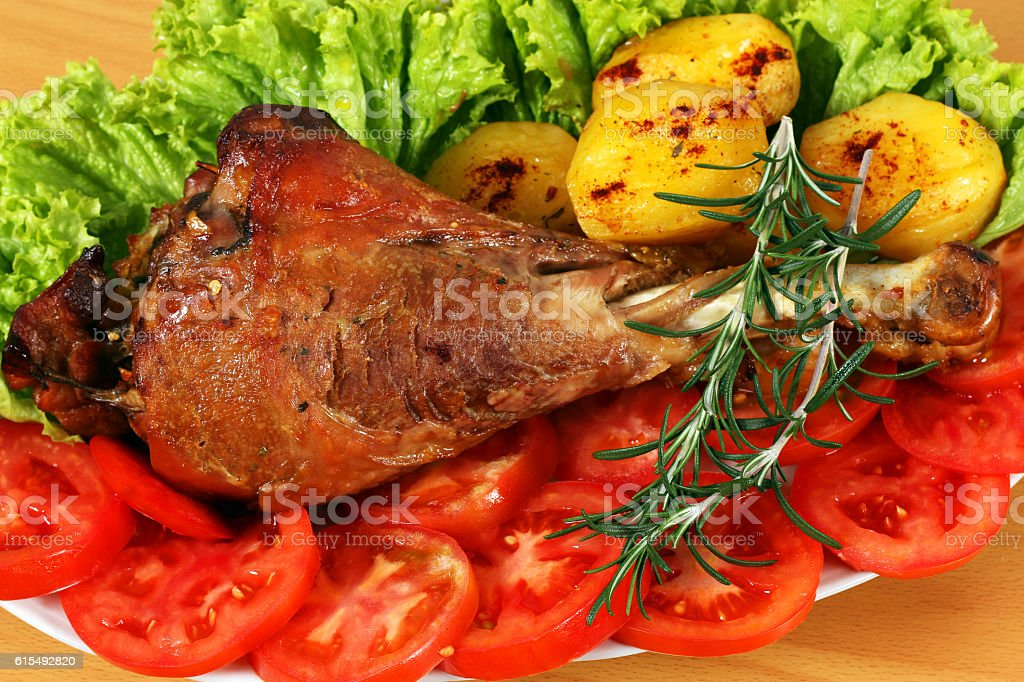 roasted turkey drumstick with vegetables closeup stock photo