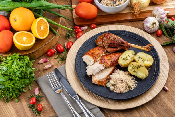 roasted turkey served on a plate with farofa, crumbs and boiled potatoes. thanksgiving day and christmas dinner. - pumpkin pie стоковые фото и изображения