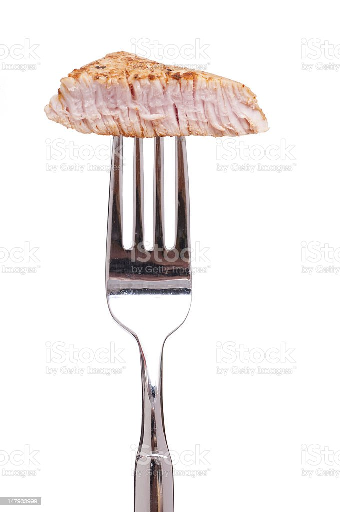 Roasted veal on a fork stock photo