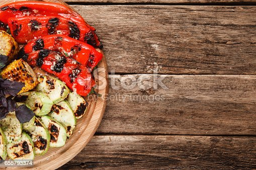 655793486 istock photo Roasted vegetables mix. Delicious vegetarian dish. 655793374