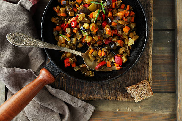 roasted vegetables pieces (tomato, aubergine, pepper) stock photo