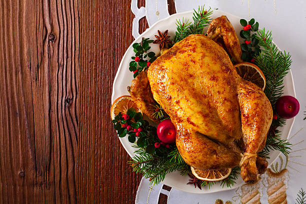 Roasted whole chicken with Christmas decoration. stock photo