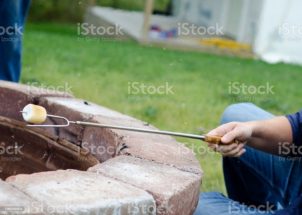 roasting a marshmallow over the fire royalty-free stock photo