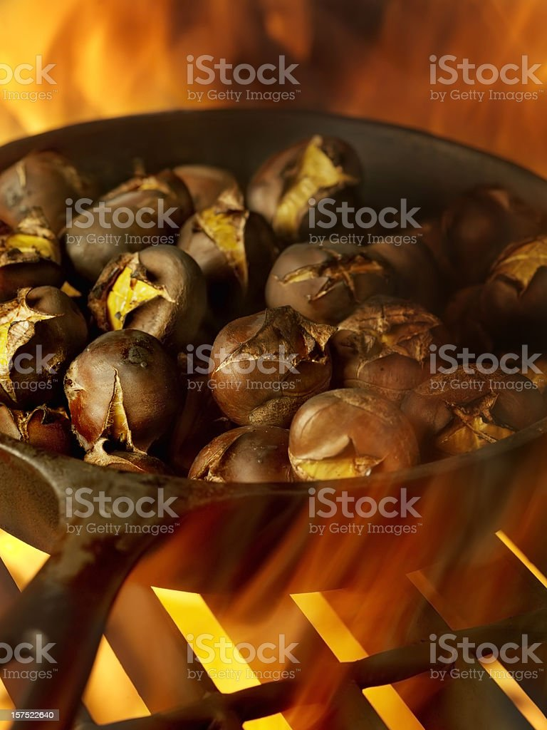 Roasting Chestnuts in a Cast Iron Pan royalty-free stock photo