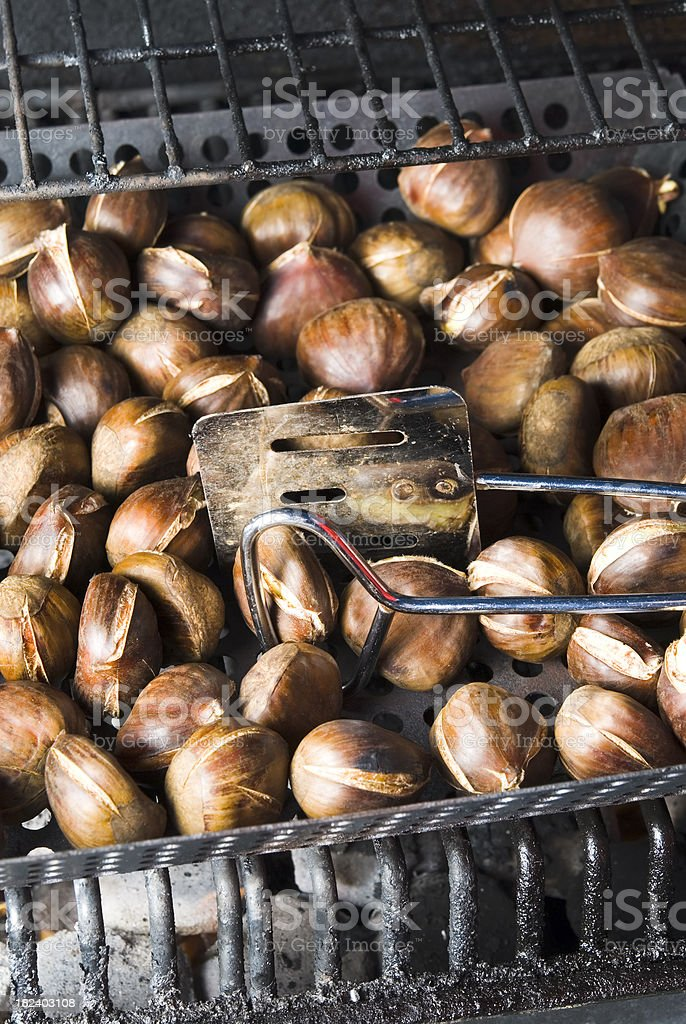 Roasting chestnuts on a BBQ - I royalty-free stock photo