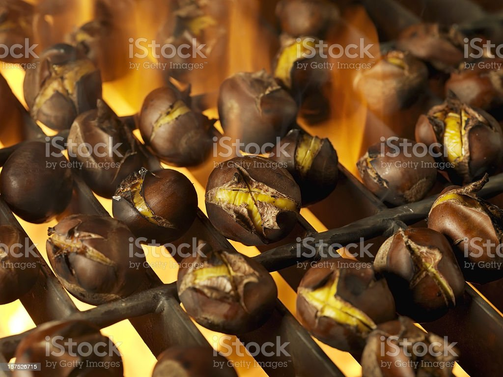 Roasting Chestnuts on an Outdoor BBQ stock photo