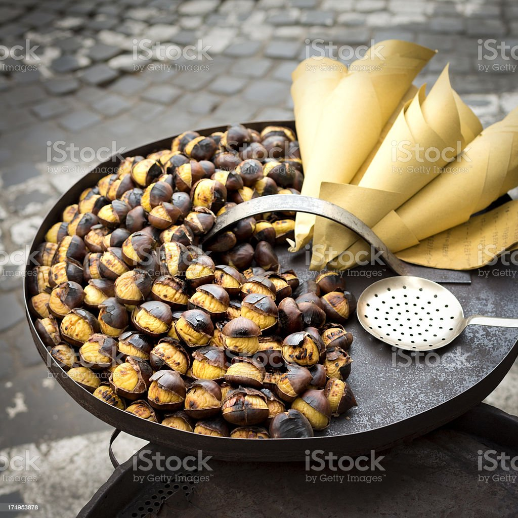 Roasting chestnuts on the street in Rome, Italy stock photo