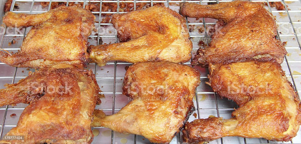 Roasting chicken on Footpath in Thailand royalty-free stock photo