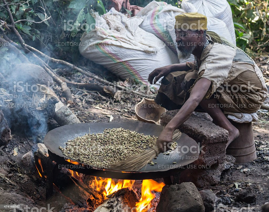Roasting coffee beans in the ethiopian way stock photo