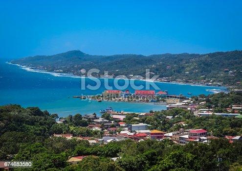 istock Roatan, Honduras landscape, bay view. Ocean, sea, laguna, local buildings, resort, green vegetation. Caribbean travel. 674683580