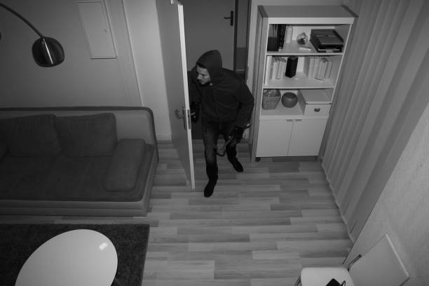 Robber Entering In House stock photo