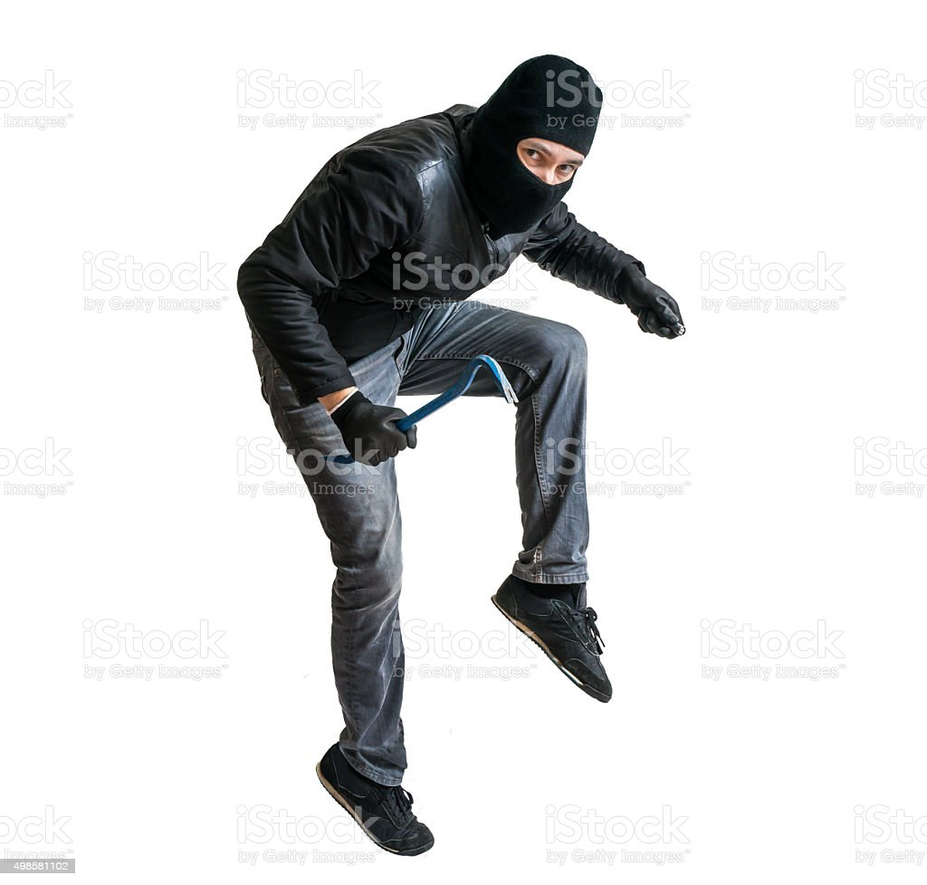Robber or burglar creeping on tiptoe. Isolated on white. stock photo