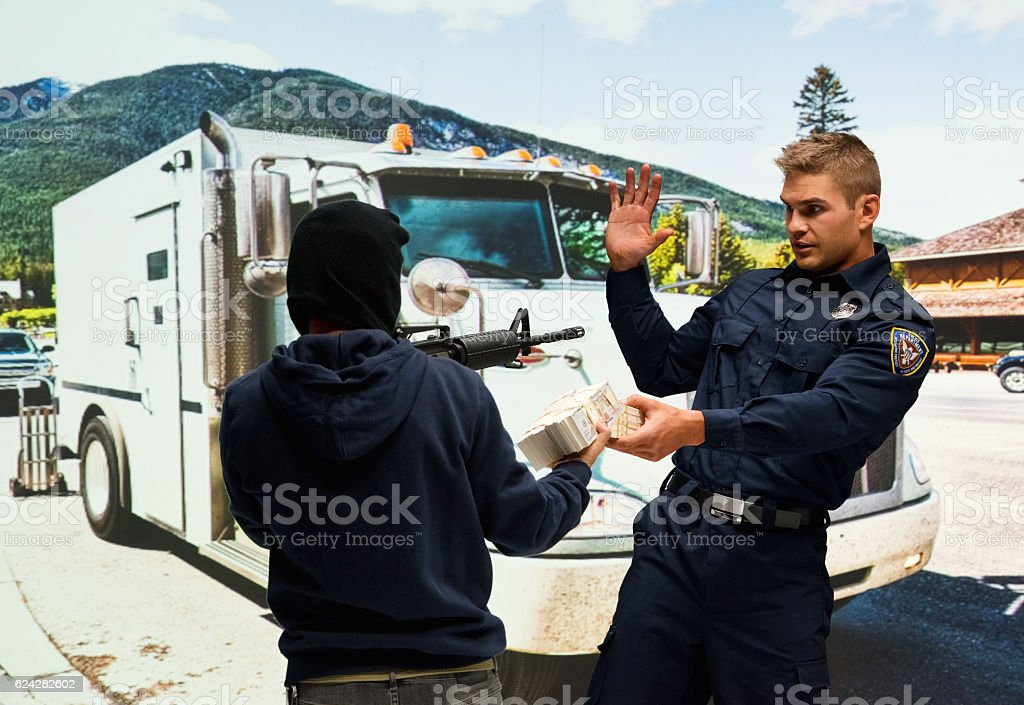 Robber robbing from police outdoors stock photo