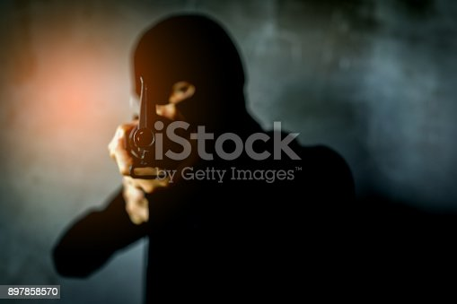 istock robber, Thief Criminal holding gun concept, Robber with masked and weapon. 897858570