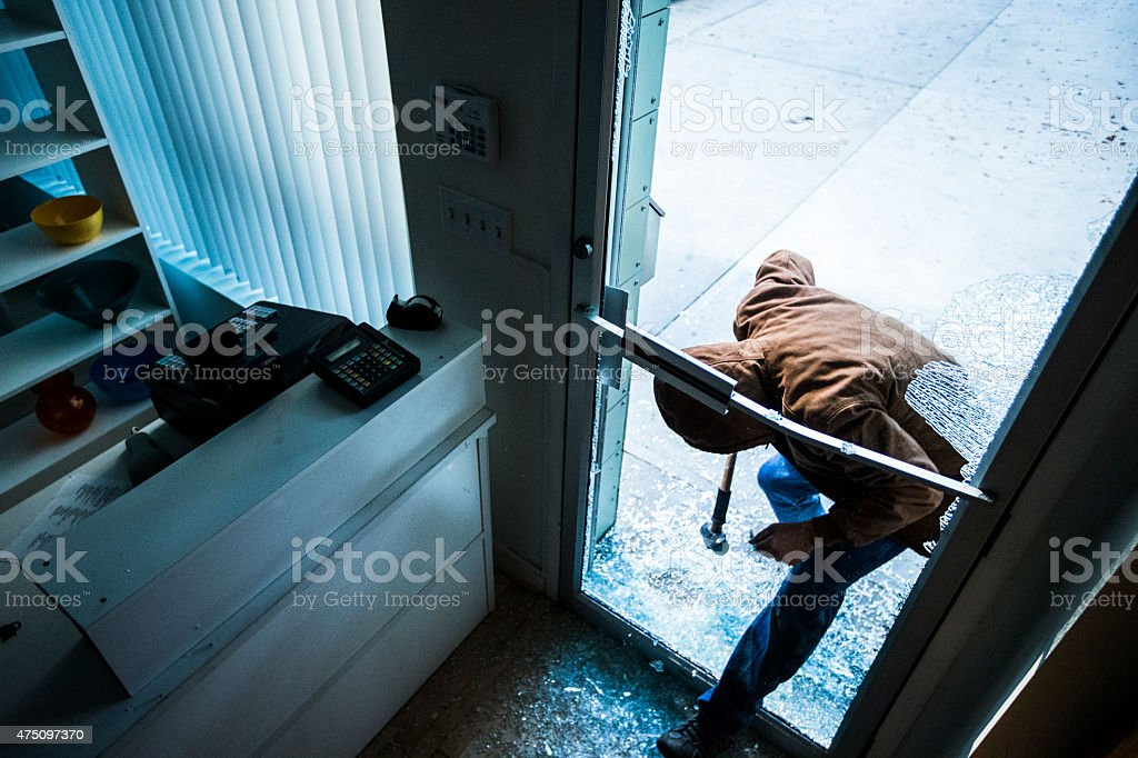 Robber using a sledgehammer, stock photo
