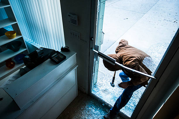 robber using a sledgehammer, - thief stock photos and pictures