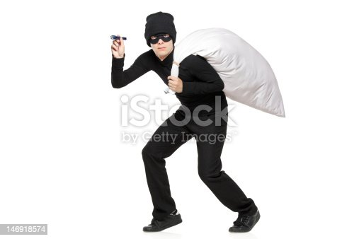 istock Robber with a bag and flashlight in hands 146918574
