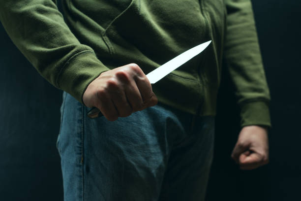 A robber with a big knife - a sharp-assassin murderer about to commit murder, robbery, theft. News articles, newspaper, social advertising A robber with a big knife - a sharp-assassin murderer about to commit murder, robbery, theft. News articles, newspaper, social advertising ambush stock pictures, royalty-free photos & images