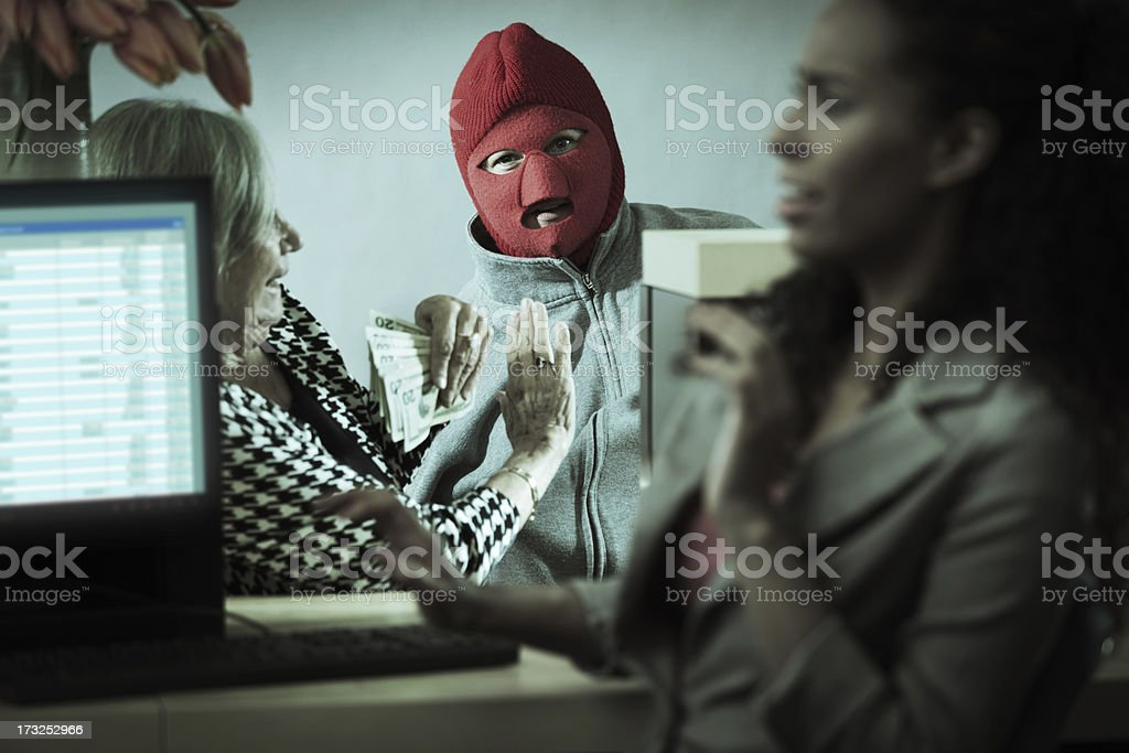 Robber with Teller and Customer in Retail Bank Window stock photo