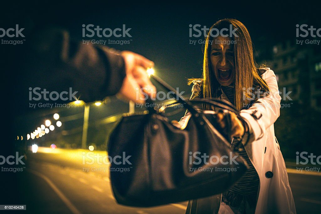 Robbery on the street stock photo